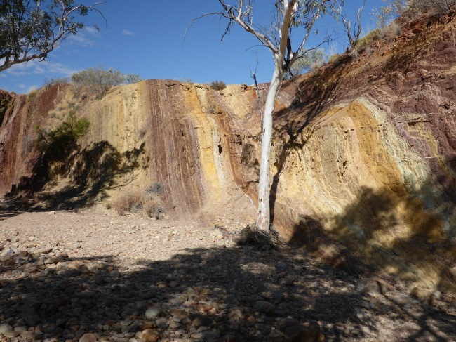 The Ochre Cliffs. Water worn patterns of colour.