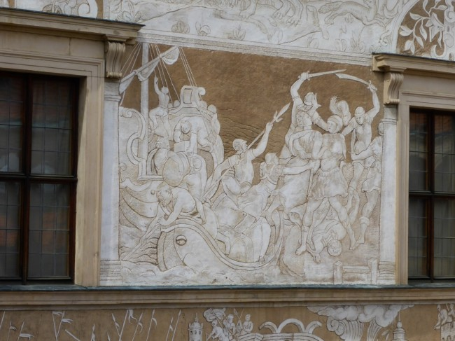 A base layer of plaster then a second one that's carved in bas relief. Nice.