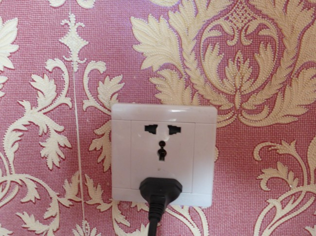 This socket could take at least three types of plug, including a British 13 amp.