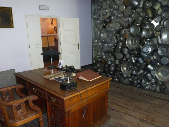 His secretary's office, with a display of some of the enamel cookware made in the factory.