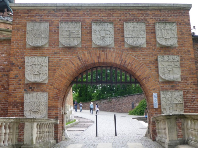 The original entrance arch with coats of arms.