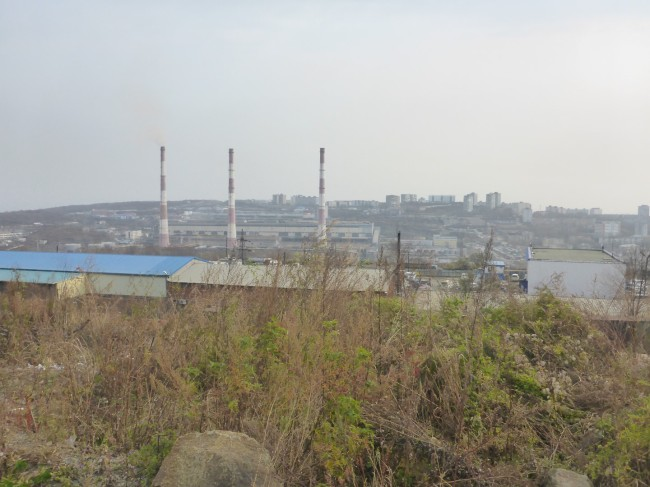 These chimneys are from the District Heating System, common in Russian towns and cities. Guilty of mass pollution.