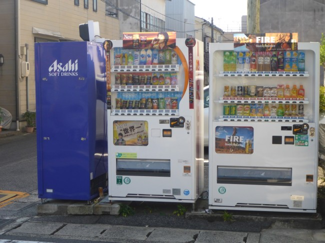 Streetside vending machines, including cans of hot coffee.