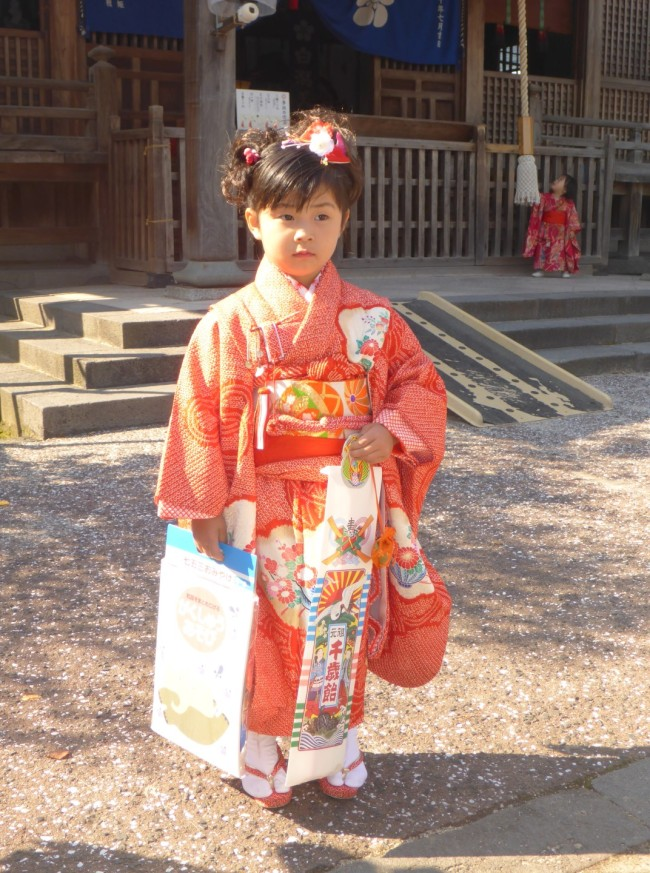 Traditionally dressed young Japanese girl.