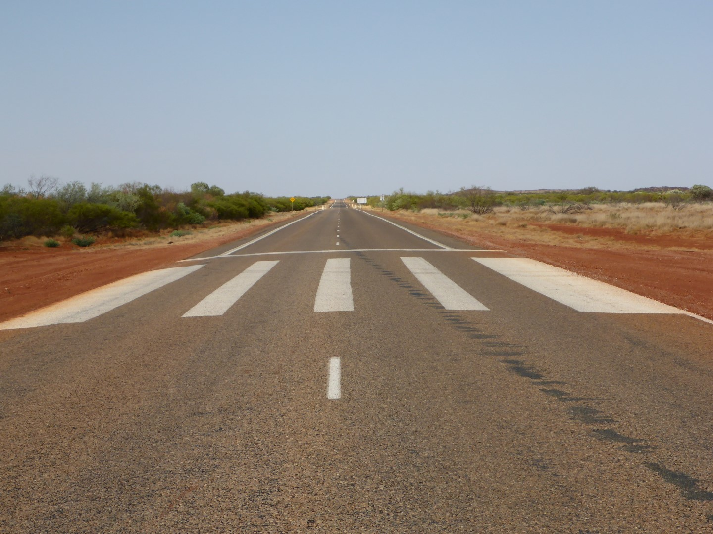 Runway markings on the road.