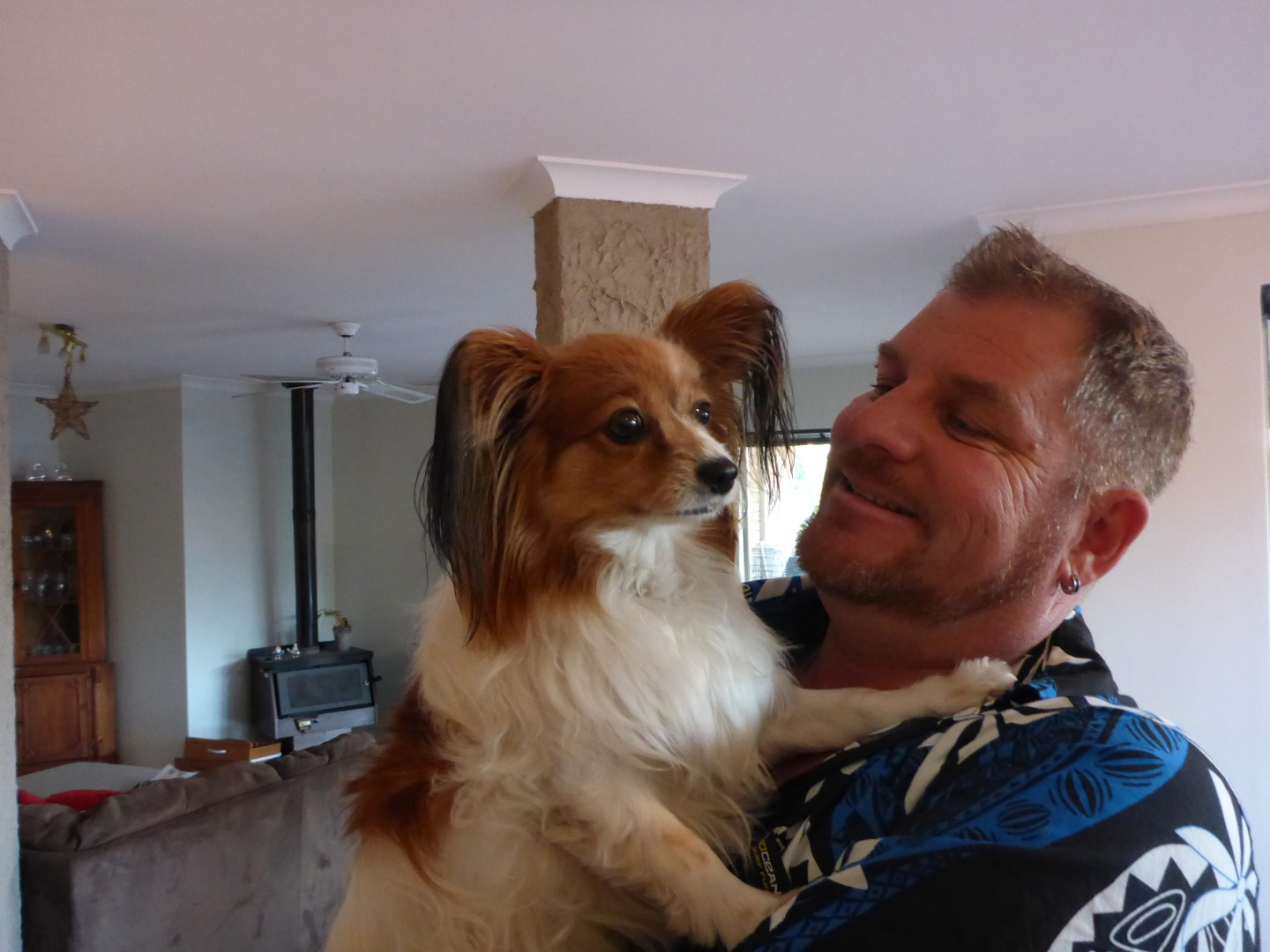 Paul and one of the family pets, a Papillion dog.