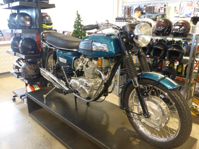 Very nice Triumph Trident in the Moto Mart clothing store.