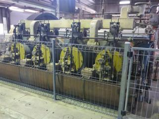 Eight cylinder gas engine. The large yellow panels are the cylinder heads.