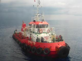 The safety boat brings some rescuees to our ship.