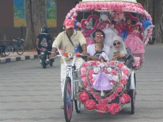 Very decorative rickshaw, and some happy tourists. Seeing Melaka the slow way.