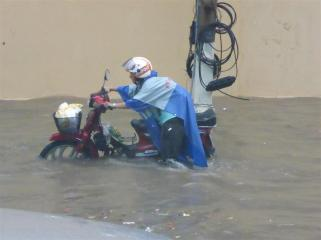 When it rains in the city the roads become flooded.