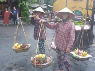 Local women pose for photos, then heavily overcharge for the fruit they sell. It's all in the game.